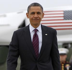 President Barack Obama walks across the tarmac before boarding Air Force One at Los Angeles International Airport in Los Angeles, Friday, May 11, 2012. (AP Photo/Pablo Martinez Monsivais)