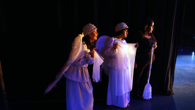 "In this Sept. 21, 2012 photo, actresses wait in the wings for their turn to walk on stage during a performance of ""Suenos,"" or ""Dreams,"" one of Ecuador's most successful musicals, at the Casa de la Cultura theater in Quito, Ecuador. The musical is based in part on the dreams of young people with disabilities and is presented by the nonprofit foundation El Triangulo. (AP Photo/Dolores Ochoa)"
