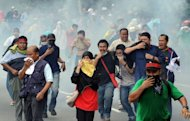 File photo shows demonstrators fleeing as Malaysian anti-riot police fire tear gas shells near Merdeka Square (Independence Square) in Kuala Lumpur. Malaysia's much dreaded colonial-era Sedition Act, which critics charged was abused to curb dissent, is to be repealed