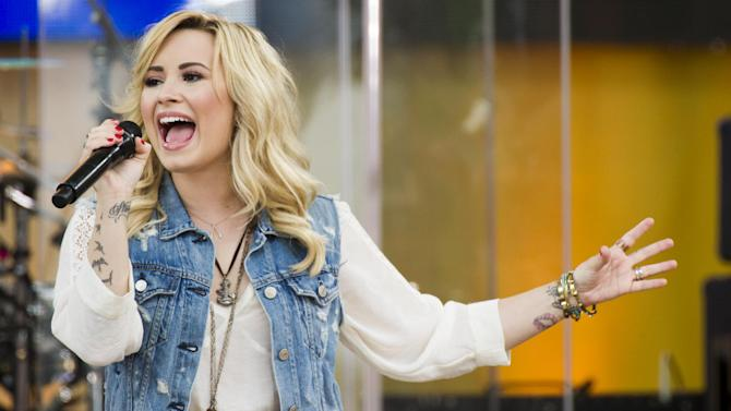 "FILE - In this June 28, 2013 file photo, Demi Lovato performs on ABC's ""Good Morning America,""  in New York. Philadelphia's Office of City Representatives says Lovato has canceled her appearance at Thursday's Fourth of July concert because of strep throat. She's being replaced by 22-year-old country singer Hunter Hays. (Photo by Charles Sykes/Invision/AP, File)"