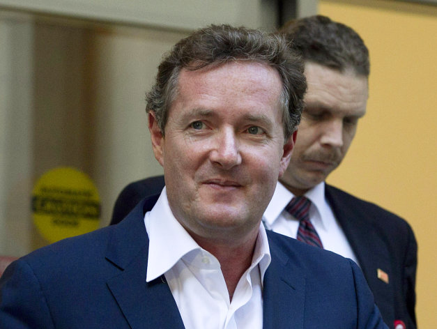 FILE - In this Dec. 20, 2011 file photo, Piers Morgan, host of CNN&#39;s &quot;Piers Morgan Tonight,&quot; leaves the CNN building in Los Angeles. More than 31,400 people have signed a petition calling for British CNN host Piers Morgan to be deported from the U.S. over his gun-control views. Morgan has taken an aggressive stand for tighter U.S. gun laws in the wake of the Newtown, Conn., school shooting. Last week, he called a gun advocate appearing on his &quot;Piers Morgan Tonight&quot; show an &quot;unbelievably stupid man.&quot; Now, gun-rights activists are fighting back. A petition created Dec. 21 on the White House e-petition website by a user in Texas accuses Morgan of engaging in a &quot;hostile attack against the U.S. Constitution&quot; by targeting the Second Amendment and demands he be deported immediately. (AP Photo/Jae C. Hong, File)