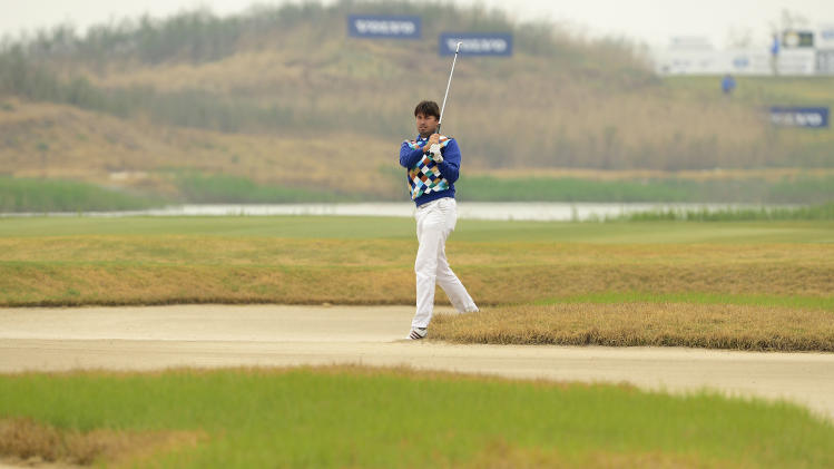 In this photo released by OneAsia, Robert-Jan Derksen of the Netherlands watches his shot during the second round of China Open golf tournament at Tianjin Binhai Lake Golf Club in Tianjin, China on Friday, May 3, 2013. (AP Photo/OneAsia, Paul Lakatos) NO LICENSING