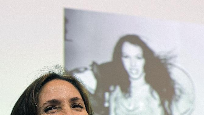 Mariela Castro, daughter of Cuban President Raul Castro, smiles while speaking during an academic conference at San Francisco General Hospital in San Francisco, Wednesday, May 23, 2012. Castro, an outspoken gay rights advocate, spoke at a medical lecture for health care providers on care for transgender patients. (AP Photo/Eric Risberg)