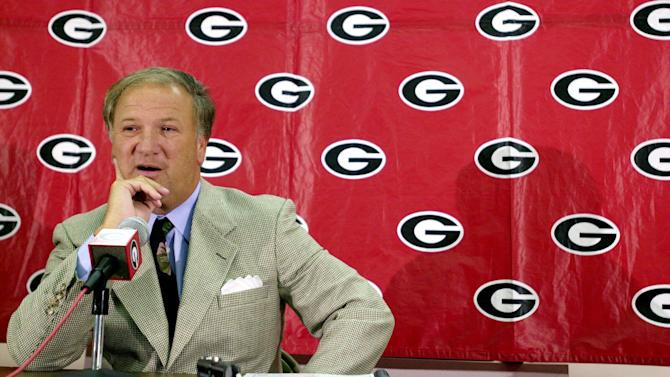 In this Aug. 7, 2000 file photo, Georgia football coach Jim Donnan speaks during the team's preseason media day in Athens, Ga. A prosecutor said former University of Georgia football coach Donnan lured his friends into a fraudulent investment scheme because he was blinded by the enormous amount of money he could make. Prosecutor Pete Peterman made that assertion Wednesday in his closing argument in Donnan's trial on charges including wire fraud, mail fraud and money laundering