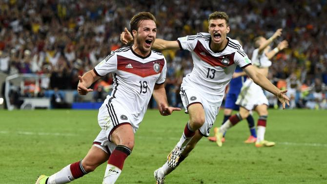 Germany's Goetze celebrates near Mueller after scoring a goal during extra time in their 2014 World Cup final against Argentina at the Maracana stadium in Rio de Janeiro