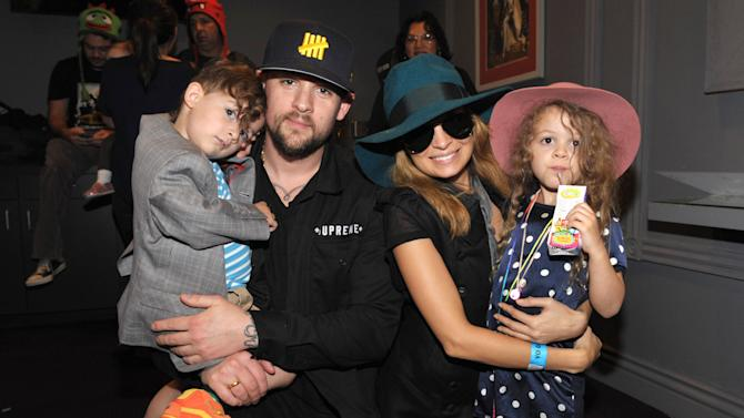 IMAGE DISTRIBUTED FOR GABBA CA DABRA - From left, Sparrow Madden, Joel Madden, Nicole Richie, and Harlow Madden attend Yo Gabba Gabba! Live!: Get The Sillies Out! 50+ city tour kick-off performance on Thanksgiving weekend at Nokia Theatre L.A. Live on Friday Nov. 23, 2012 in Los Angeles. (Photo by John Shearer/Invision for GabbaCaDabra, LLC./AP Images)