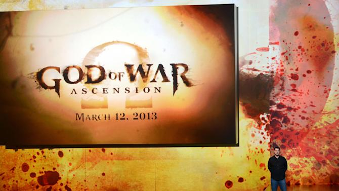 COMMERCIAL IMAGE - In this image provided by Sony Computer Entertainment America, Todd Papy, Game Director, God of War Ascension, reveals the release date of the next iteration of the acclaimed God of War franchise during the Sony Playstation press conference at E3 on Monday, June 4, 2012 in Los Angeles. (Chris Week/AP Images for Sony Computer Entertainment America)
