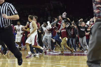 Inside the court storming: Temple crushes No. 10 Kansas by 25