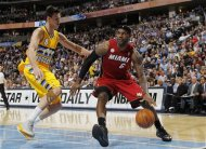 Miami Heat forward LeBron James, right, works the ball inside as Denver Nuggets forward Danilo Gallinari, of Italy, covers in the first quarter of an NBA basketball game in Denver, Thursday, Nov. 15, 2012. (AP Photo/David Zalubowski)