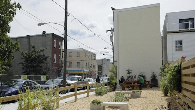 A vacant lot owned by the Philadelphia Redevelopment Authority is shown, Thursday, Sept. 20, 2012, in Philadelphia. Ori Feibush, a real estate developer, has turned a trash-strewn city-owned lot, vacant for roughly 30 years, into a welcoming spot for customers of his month-old corner cafe. But city officials say Feibush shouldn't have done work on a lot he doesn't own or rent, shouldn't be using taxpayer-owned property to benefit his business. (AP Photo/Matt Slocum)