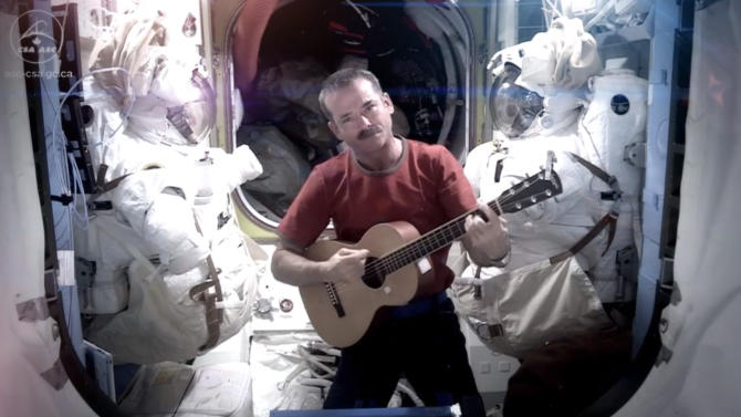 This image provided by NASA shows astronaut Chris Hadfield recording the first music video from space Sunday May 12, 2013. The song was his cover version of David Bowie's Space Oddity. Hadfield and astronaut Thomas Marshburn are scheduled to return to earth Monday May 13, 2013. (AP Photo/NASA, Chris Hadfield)