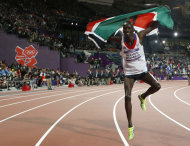Kenya&#39;s Ezekiel Kemboi celebrates winning gold in the men&#39;s 3000-meter steeplechase during the athletics in the Olympic Stadium at the 2012 Summer Olympics, London, Sunday, Aug. 5, 2012. (AP Photo/Matt Dunham)