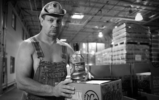 "A bottle of ""Moonshiners"" star Tim Smith's Climax moonshine allegedly resulted in a girls' basketball coach's firing -- climaxmoonshine.com"