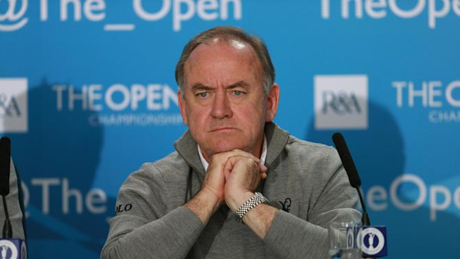 The Royal and Ancient Golf Club's Chief Executive Peter Dawson attends a press conference ahead of the British Open Golf championship at the Royal Liverpool golf club, Hoylake, England, Wednesday July 16, 2014. The British Open Golf championship starts Thursday July 17. (AP Photo)