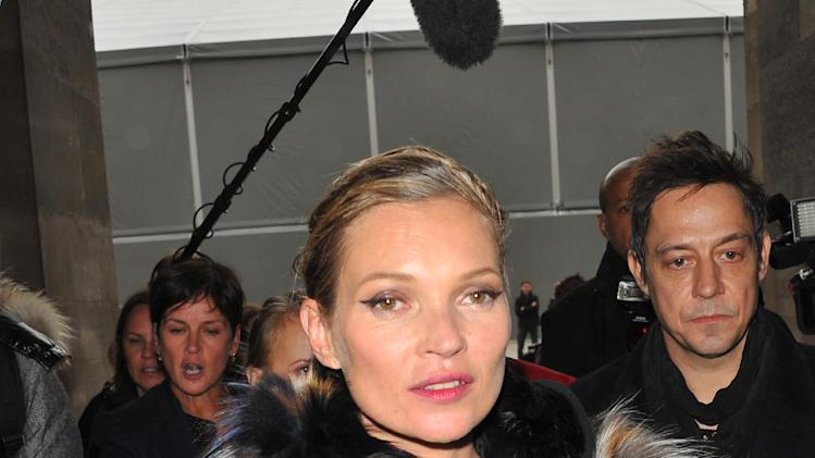 Top model Kate Moss and Jamie Hince, right, leave Louis Vuitton's Ready to Wear's Fall-Winter 2013-2014 fashion collection, Wednesday, March 6, 2013 in Paris. (AP Photo/Zacharie Scheurer)