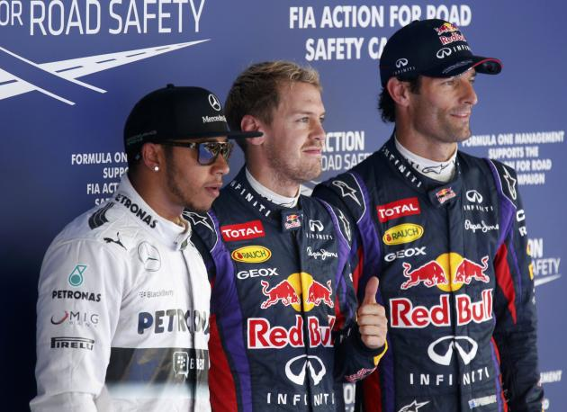 Red Bull Formula One driver Vettel poses with Mercedes Formula One driver Hamilton and Red Bull Formula One driver Webber after the qualifying session for the Korean F1 Grand Prix in Yeongam