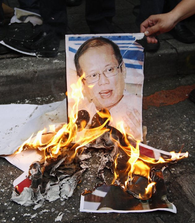 Activists burn portraits of Philippine President Aquino during a protest against the Philippine government in front of the Manila Economic and Cultural Office, the de facto Philippine embassy in Taiwa