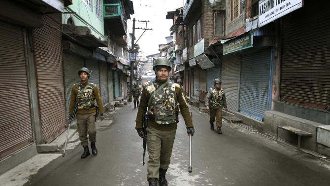FILE - In this  Jan. 15, 2013 file photo, Indian paramilitary soldiers patrol during a curfew imposed after protests against the execution of Kashmiri Mohammad Afzal Guru in Srinagar, India. India has hanged two men in the past three months, its first executions in eight years. In a departure from past practice, both were done in secrecy. Rights activists worry the government has set a precedent that could impact the nearly 500 people on death row in India, including four men whose mercy pleas - their last hope of life - were rejected by India's president last week. (AP Photo/ Mukhtar Khan, File)