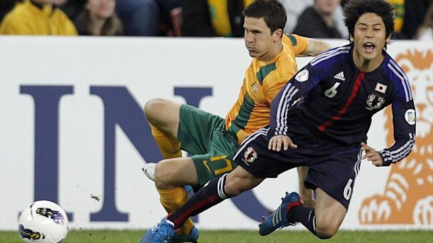 Australia's Matt McKay (L) fights for the ball with Japan's Atsuto Uchida (Reuters)