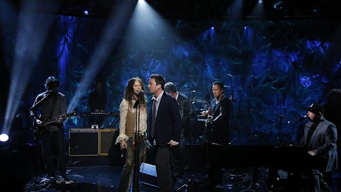 "In this photo provided by NBC, from second left, Steven Tyler, Jimmy Fallon, Bruce Springsteen and Billy Joel perform during ""Hurricane Sandy: Coming Together"" Friday, Nov. 2, 2012, in New York. Hosted by Matt Lauer, the event is heavy on stars identified with New Jersey and the New York metropolitan area, which took the brunt of this week's deadly storm. (AP Photo/NBC, Heidi Gutman)"