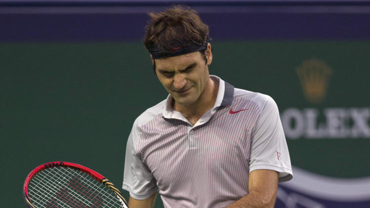 Federer ousted by Monfils in Shanghai Masters