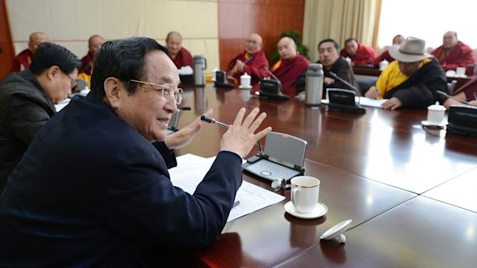 In this Jan. 8, 2013 photo released by China's Xinhua News Agency, Yu Zhengsheng, front, a Standing Committee member of the Political Bureau of the Communist Party of China (CPC) Central Committee, speaks during a seminar held with Tibetan Buddhist representatives in Ganzi Tibetan Autonomous Prefecture, southwest China's Sichuan Province. Yu visited Ganzi at the center of the self-immolations, urging Buddhist clergy to be patriotic and denouncing the Dalai Lama. Chinese authorities are responding to an intensified wave of Tibetan self-immolation protests against Chinese rule by clamping down even harder — criminalizing the suicides, arresting protesters' friends and even confiscating thousands of satellite TV dishes. (AP Photo/Xinhua, Ma Zhancheng) NO SALES