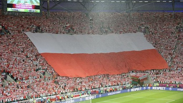 Polish fans wave a giant flag
