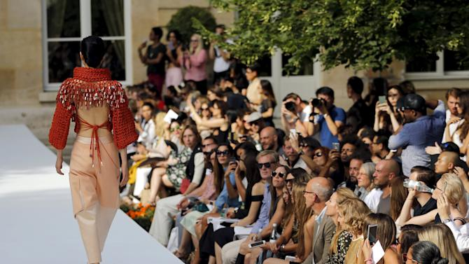 Model presents a creation by designer Ilja as part of her Haute Couture Fall Winter 2015/2016 fashion show in Paris