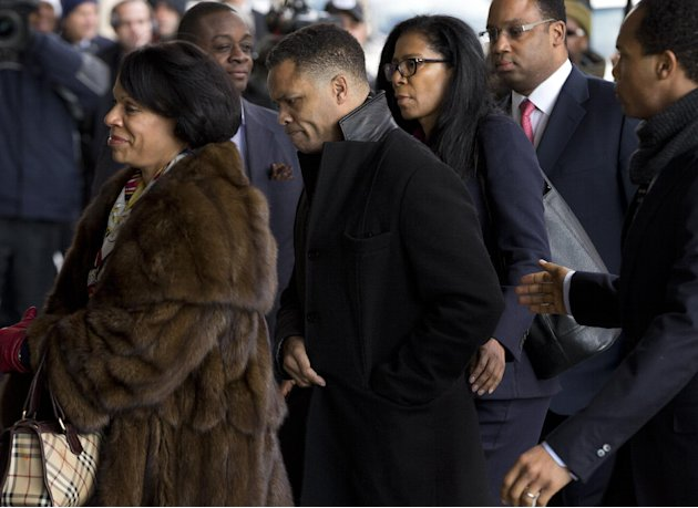 Former Illinois Rep. Jesse Jackson Jr., center, arrives at the E. Barrett Prettyman Federal Courthouse in Washington, Wednesday, Feb. 20, 2013. Jackson and his wife were to appear in federal court to