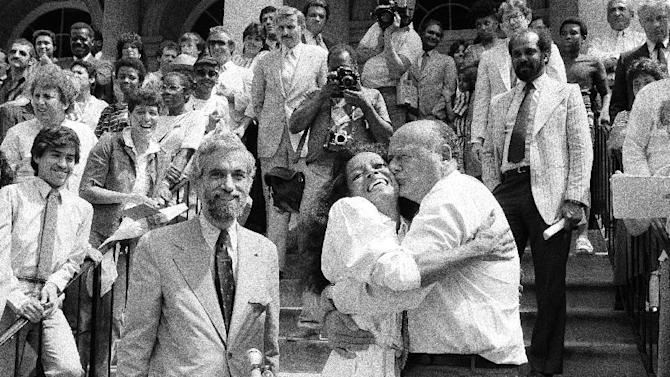 FILE - In this July 6, 1983, file photo, New York Mayor Ed Koch kisses singer-actress Diana Ross at the steps of City Hall in New York. Koch, the combative politician who rescued the city from near-financial ruin during three City Hall terms, has died at age 88. Spokesman George Arzt says Koch died Friday morning Feb. 1, 2013 of congestive heart failure. (AP Photo/Marty Lederhandler, File)