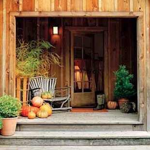 Pumpkins and winter squash dress up a porch