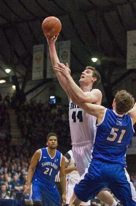 Butler's Andrew Smith (44) goes up for a basket as Saint Louis' Rob Loe (51) tries to defend during the first half of an NCAA college basketball game  Friday, Feb. 22, 2013, in Indianapolis. (AP Photo/Doug McSchooler)