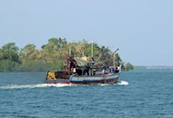 A Filipino-owned fishing boat sails off from the port of Masinloc town, Zambales province, north of Manila, in May 2012. The Philippines said on Monday they believed a Hong Kong vessel may have rammed a Filipino fishing boat, leaving one person dead and four missing, after initially suspecting China over the accident