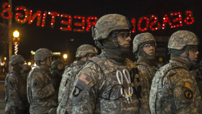 Members of the National Guard stand guard outside the Ferguson Police Department in Missouri