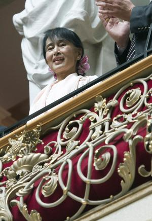 Myanmar opposition leader Aung San Suu Kyi sits on the balcony during her visit to the government building in Bern, Switzerland, Friday, June 15, 2012. The European trip is seen as a sign of gratitude to governments and organizations that supported Suu Kyi's peaceful struggle against Myanmar's former military rulers over more than two decades, 15 years of which she spent under house arrest. (AP Photo/Lukas Lehmann)