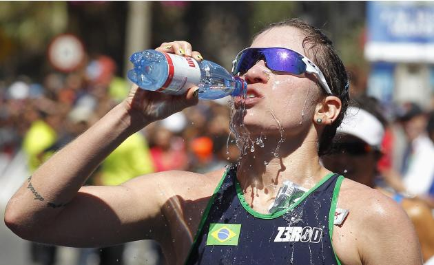 Oliveira of Brazil drinks water after participating in the women's triathlon during the South American Games in Vina del Mar