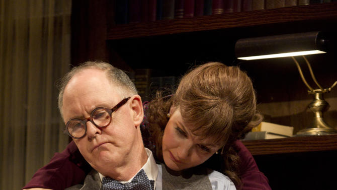 """In this theater image released by Boneau/Bryan-Brown, John Lithgow portrays columnist and political pundit Joseph Alsop, left, and Margaret Colin portrays Susan Mary Alsop in a scene from the play """"The Columnist,"""" playing at the Samuel J. Friedman Theatre in New York. (AP Photo/Boneau/Bryan-Brown, Joan Marcus)"""