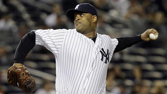 New York Yankees starting pitcher CC Sabathia delivers against the Boston Red Sox in the second inning of their baseball game at Yankee Stadium in New York, Monday, Oct. 1, 2012. (AP Photo/Kathy Willens)