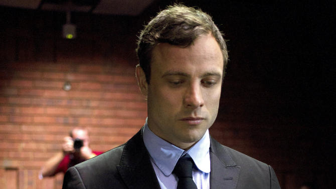 FILE In this file photo taken Monday, Aug. 19, 2013 double-amputee Olympian Oscar Pistorius, at the magistrates court in Pretoria, South Africa, when Pistorius was indicted on charges of murder and illegal possession of ammunition for the shooting death of his girlfriend on Valentine's Day. Oscar Pistorius' lawyers are working with a team of American forensic specialists to help prepare the double-amputee Olympian's defense, and likely counter any evidence given by the nearly 50 police officers and criminal experts that prosecutors could call at his murder trial early next year. The U.S. forensic team is now in South Africa, Pistorius' spokeswoman told The Associated Press on Tuesday, Oct. 1, 2013, although she could not give any details of their identities or areas of expertise, or if they would stay for the trial, which begins in March and has been scheduled to last just over two weeks. (AP Photo/Themba Hadebe, File)