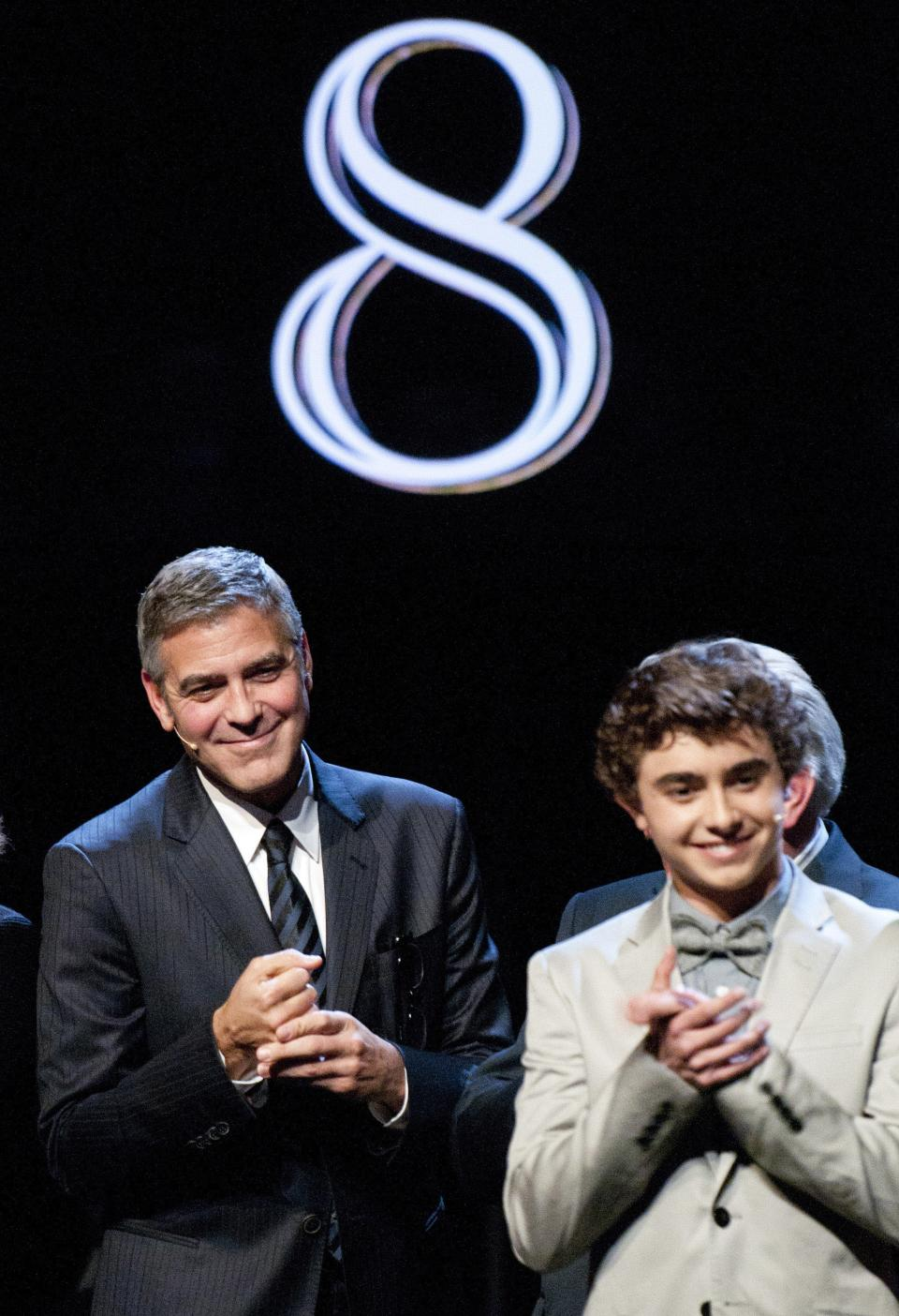 "Actor George Clooney, left, and actor Jansen Panettiere take a bow during the curtain call at the Los Angeles premiere of the play ""8"" in Los Angeles on Saturday, March 3, 2012. (AP Photo/Dan Steinberg)"