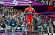 "China's Liu Xiang hops off the track after falling during the men's 110m hurdles heats at the athletics event of the London 2012 Olympic Games on August 7, in London. Liu has had ""very successful"" surgery on the injury that dashed his Olympic hopes and put his career in doubt, a senior official said on Sunday"