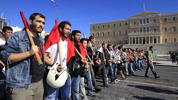 Protesters shout slogans in front of the Parliament in Athens on Tuesday Nov. 6, 2012. Greece's unions are holding their third general strike in six weeks to press dissenters in the country's troubled coalition government not to back a major new austerity program that will doom Greeks to further hardship in a sixth year of recession. (AP Photo/Nikolas Giakoumidis)