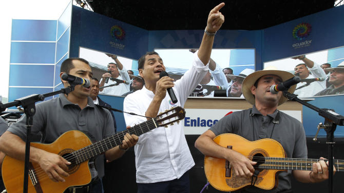 "Ecuador's President Rafael Correa, center, sings with a band before the start of his his weekly broadcast ""Enlace Ciudadano,"" or ""Citizen Link"" in Manta, Ecuador, Saturday, June 29, 2013. While the Ecuadorean government appeared angry over U.S. threats of punishment if it accepts U.S. National Security Agency leaker Edward Snowden, there were also mixed signals about how eager it was to grant asylum. (AP Photo/Martin Mejia)"