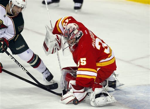 Stajan scores 2 goals in Flames 3-1 win over Wild