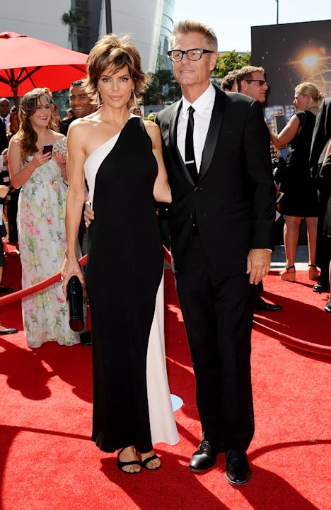From left, Lisa Rinna and Harry Hamlin arrive at the 2013 Primetime Creative Arts Emmy Awards, on Sunday, September 15, 2013 at Nokia Theatre L.A. Live, in Los Angeles, Calif. (Photo by Scott Kirkland