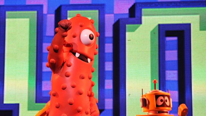 Muno, left, and Plex perform onstage at Yo Gabba Gabba! Live!: Get The Sillies Out! 50+ city tour kick-off performance on Thanksgiving weekend at Nokia Theatre L.A. Live on Friday Nov. 23, 2012 in Los Angeles. (Photo by John Shearer/Invision for GabbaCaDabra, LLC./AP Images)
