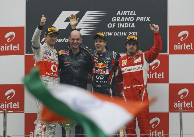 Winner Red Bull driver Sebastian Vettel of Germany, second from right, poses with Ferrari driver Fernando Alonso of Spain, right, third place, Red Bul chief technical officer Adrian Newey and McLaren