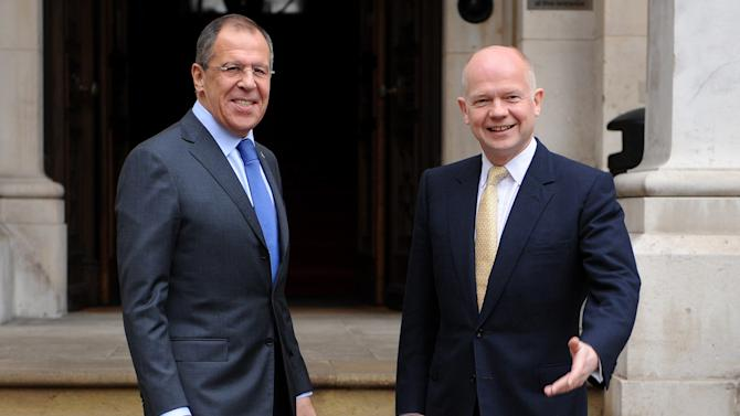 British Foreign Secretary William Hague, right, greets Russian Foreign Minister Sergei Lavrov as he arrives at the Foreign and Commonwealth Office for a bilateral meeting, in London, Tuesday Feb. 15, 2011.  Lavrov started a two-day visit to Britain on Monday to improve relations still marred by a succession of Cold War-style scandals, despite a landmark oil deal that underlined the potential of economic ties.(AP Photo/Ben Stansall, pool)
