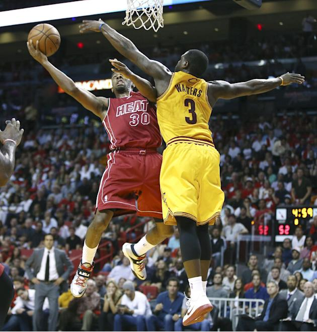 Cleveland Cavaliers' Dion Waiters (3) tries to block Miami Heat's Norris Cole (30) during the first half of an NBA basketball game in Miami, Saturday, Dec. 14, 2013