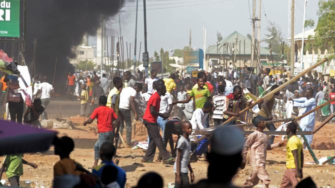 People protest against the increased violence ahead of a visit by Nigerian President Jonathan to the state, after an suicide bomb explosion in Gombe